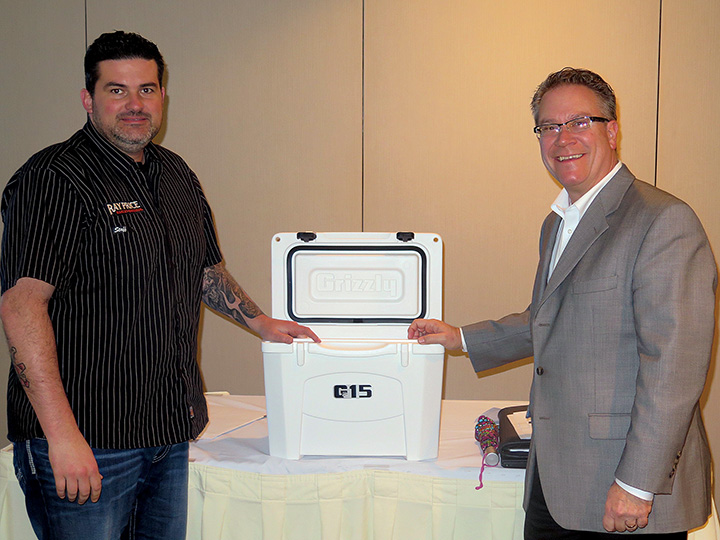 Mark Hendrix won a cooler in a prize drawing by Federated Insurance's Scott Raymer.